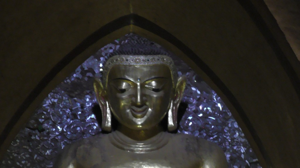 The Buddha in Ananda temple smiles from remote.